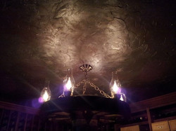 Venitian plastered ceiling painted in Ben Moore's Stormy Sky, topped with silver metallic accents