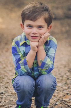 boy kneeling family photography session.