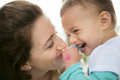 MOTHER AND DAUGHTER TODDLER LAUGHING.jpg