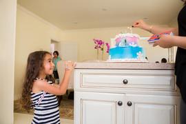 BIRTHDAY GIRL WAITING FOR BIRTHDAY CAKE