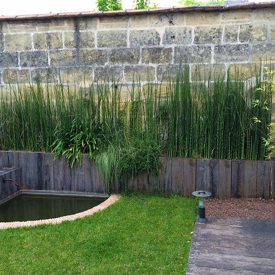 Aménagement d'un bassin dans un jardin du centre de Bordeaux