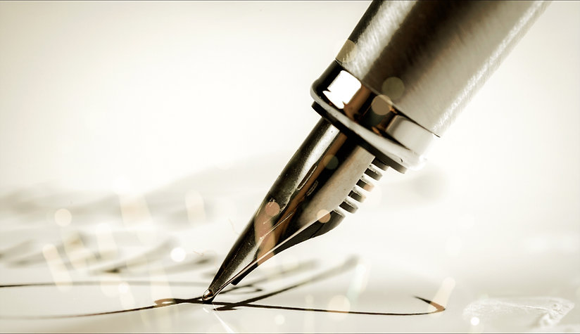 Signing a signature with a fountain pen.