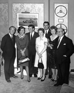 Colin Chapman & his wife, Jim Clark, Jack Brabham & his wife, Haysie & John