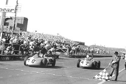 British GP Aintree 1955,  John waves Chequered Flag for Moss & Fangio