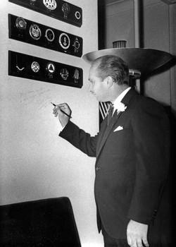 Fangio signs Steering Wheel Club wall, 1979