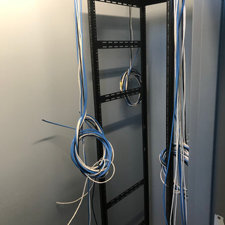 Wiring coming down to the new 42U rack that will house all equipment.