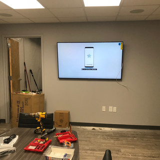 """65"""" Samsung display installed in the conference room for meetings."""