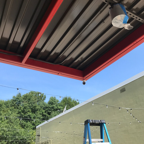 Exterior bullet camera on the front canopy surveys the main enterance to the restaurant.