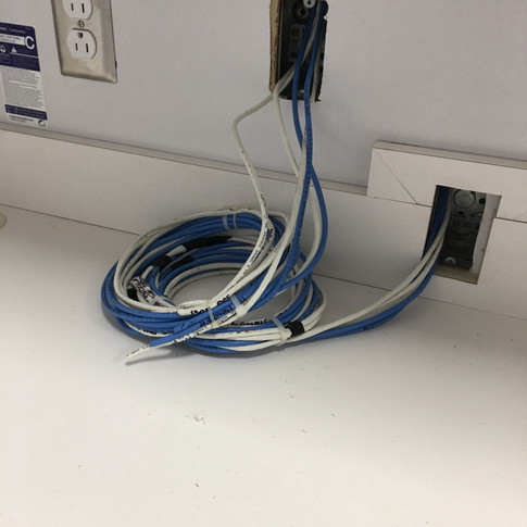 POS terminal wiring inside the main office.