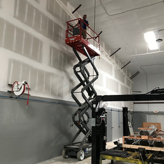 High ceilings in the main shop area required the use of scissor lifts for the pre-wire.