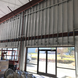 Pre-wire for 4 70v commercial speakers across the front of the Showroom.
