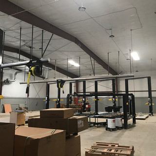 Ruckus access points going up on the tall shop ceilings. The APs provide seamless roaming capabilities throught the facility.