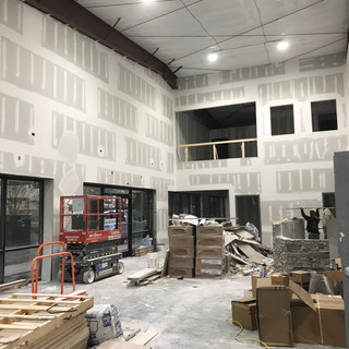 Sheetrock installed in the showroom. Ready for trim out!