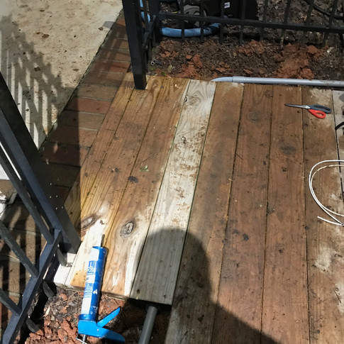 Conduit goes straight under this walkway. We removed one of the planks and this is the result. Nice and clean!