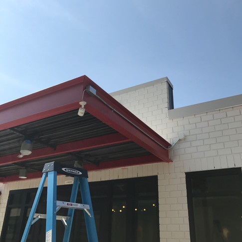 EMT conduit installed on the canopy to the camera location. When this is painted to match the canopy it will blend right in with the industrial feel of the construction!
