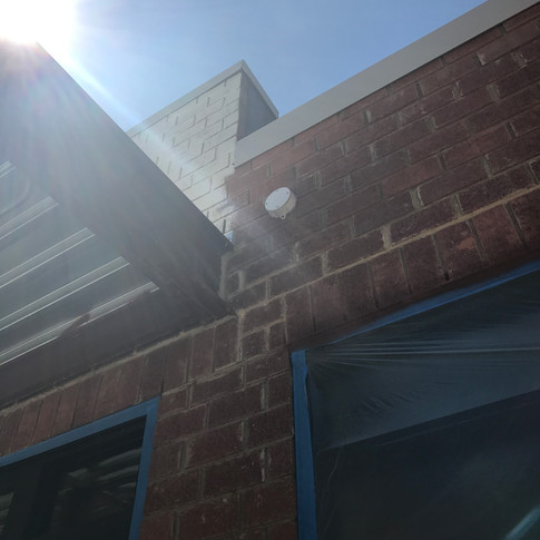 No conduit sleeves were provided during rough in, so we had to drill through the concrete and brick for all exterior camera locations.