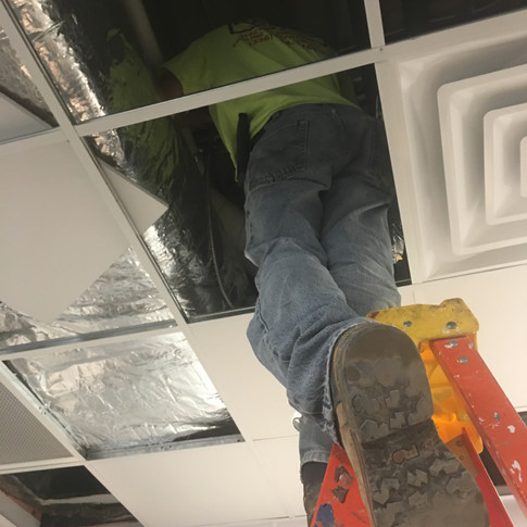 Wires being pulled through the drop ceiling.