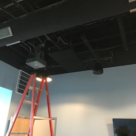 We even added black acoustic panels to cut echo and reverberation in the space. They are incredibly effective!