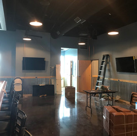 """55"""" Samsung displays going up. All video for this project is matrixed from the rack."""