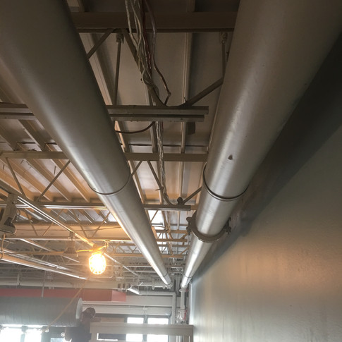 Organizing and strapping wiring to the open ceiling structure.