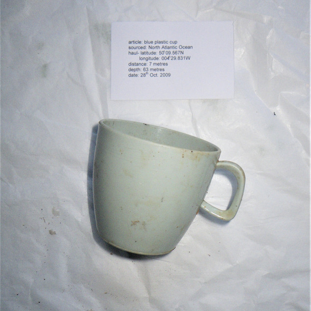 article: blue plastic cup sourced on the N. Atlantic seabed haul: latitude 50 degrees 09.567N longitude 004 degrees 29.831W distance 7 metres depth 63 metres date 28th October 2009