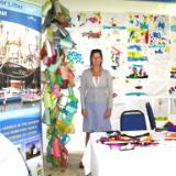 Collages on the wall made by children depicting fish in the ocean. 2010