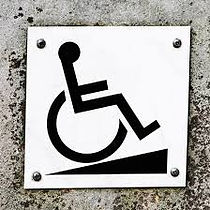 International Symbol of Accessibility going up a ramp.