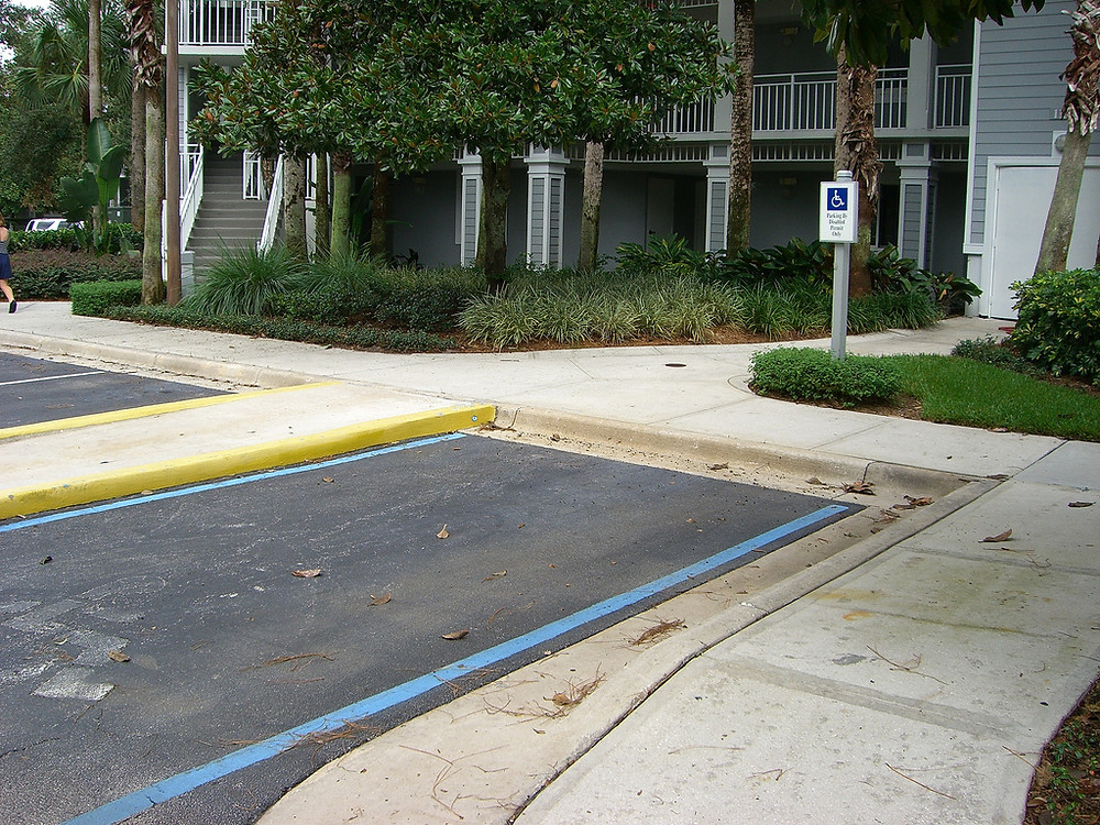 Access aisle to be at same level as accessible parking space