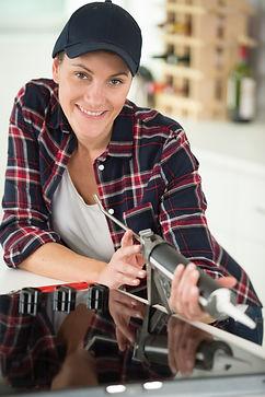 woman holding silicone gun to use around