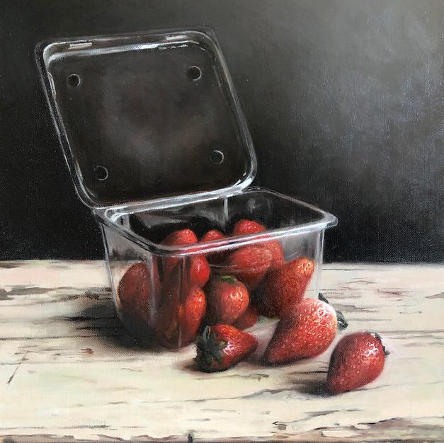 Strawberries in unnecessary plastic punnet