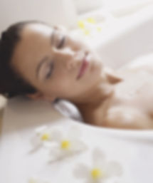 Woman relaxing in a bath