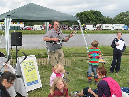 Folk performance, children's concert, open air music, Albo, Little Folk with Albo, Wimbledon Village Fair, family concert
