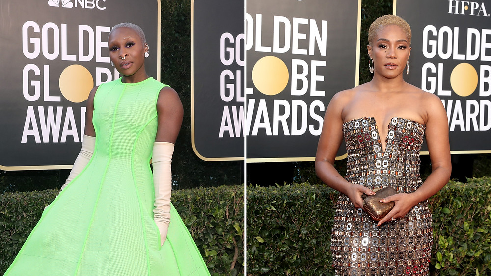 To left, Cynthia Ervo in neon green dress and long gloves. To right, Tiffandy Haddish in embellished, gold dress.