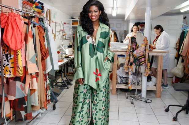 Felisha Noel wears her eye-catching, silk designs in light green and orange patterns