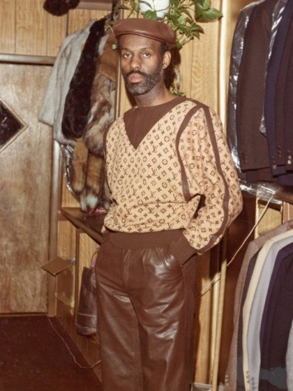 Dapper Dan wears one his signature creations: a cream sweater with brownLouis Vuitton print.
