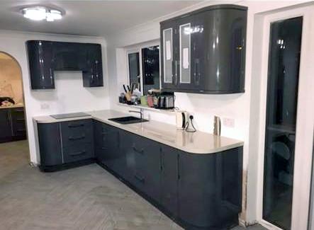 Dark gloss kitchen cabinets set with marble worktop