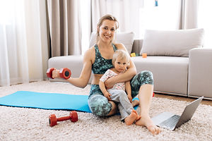 Home workout. Young attractive mom doing