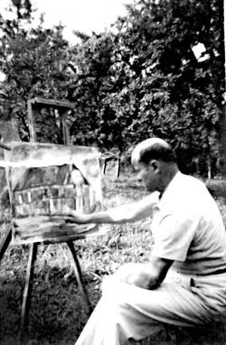 Roman Greco peignant dans son jardin