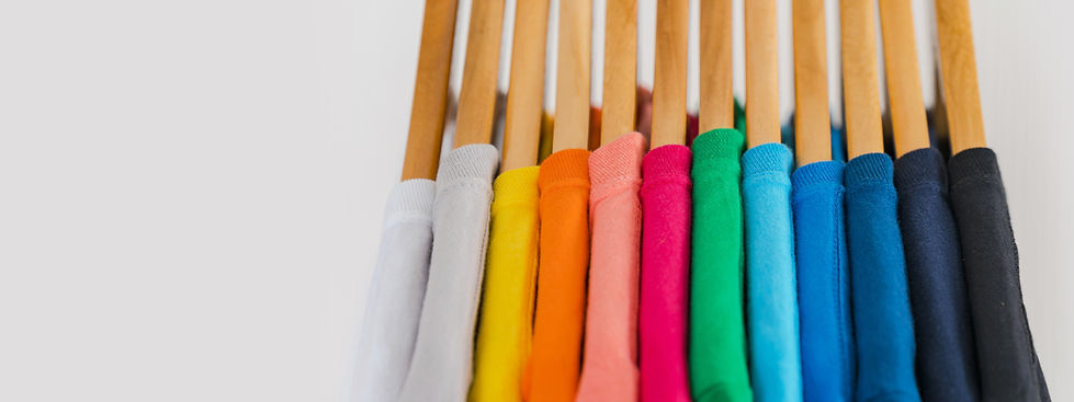 close-up-of-colorful-t-shirts-on-hangers