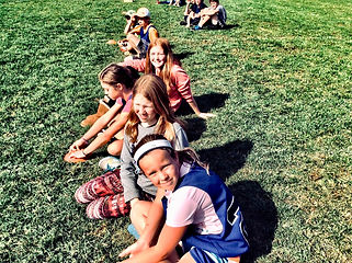 Group of children sitting on grass