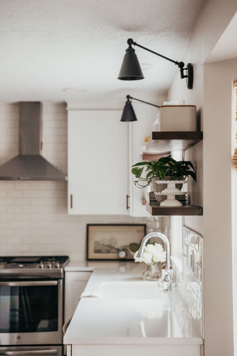 Library Sconces Above Open Shelving
