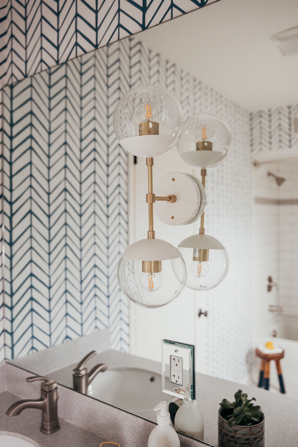 Wall sconce installed on bathroom mirror