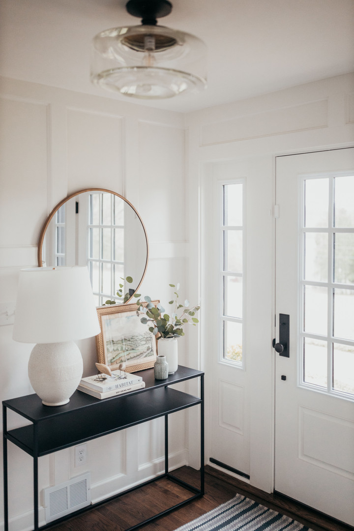 Bright Entryway with Millwork