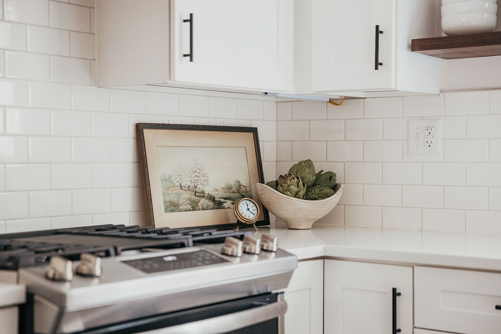 Bright white kitchen with subway tile backsplash by Christine McCall Home, a Pittsburgh based interior designer