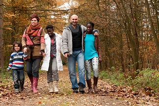 The photo illustrates the kind of foster family particularly needed - one caring for older children.