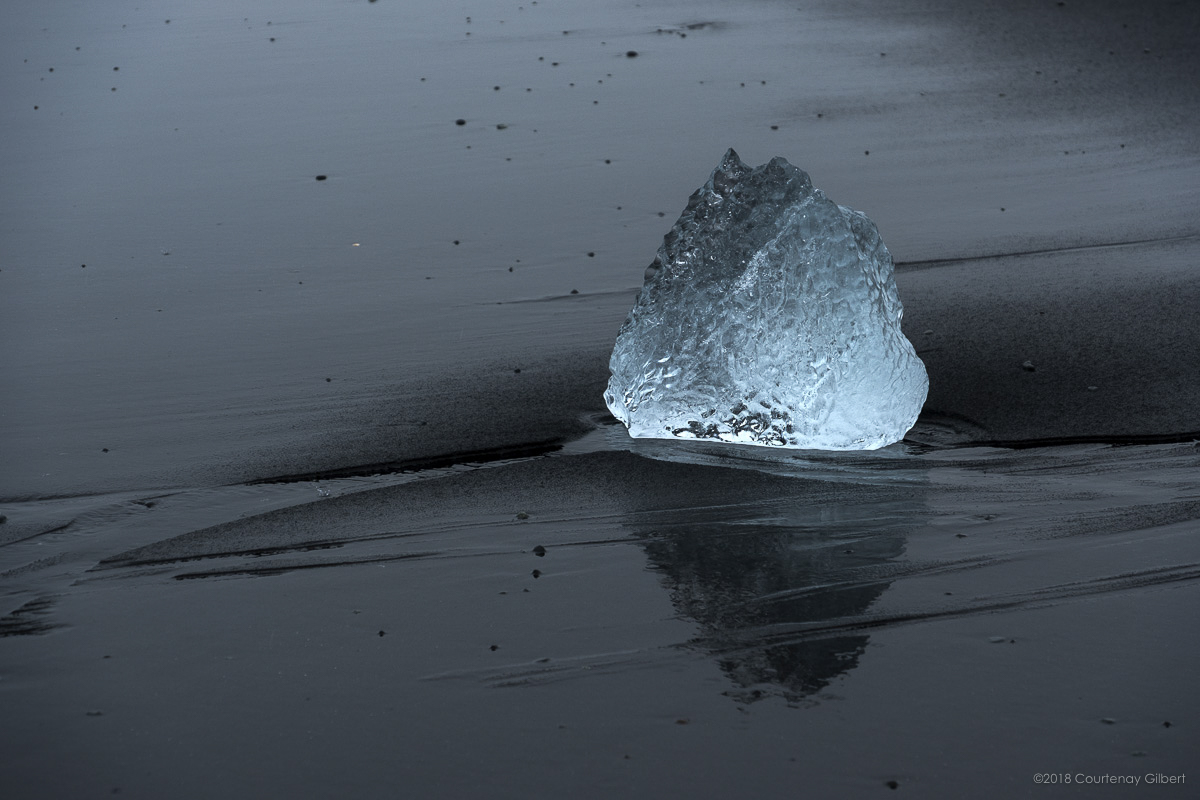 Ice on black sand