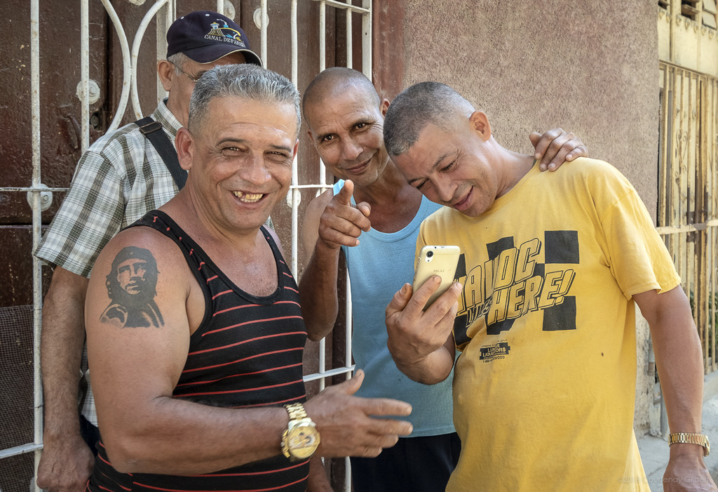 Men with Cell Phone, Havana, Cuba