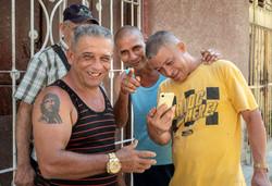 Men with Cell Phone, Havana, Cuba