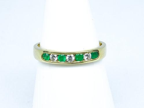 7 stone emerald & diamond channel set ring