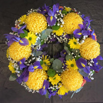 Yellow and Purple Flower Funeral Wreath.